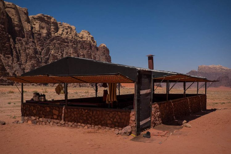 Authentic Bedouin communal tent in red desert with open windows