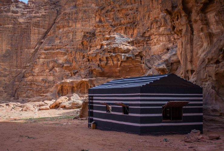 Bedouin Group Tent at base of sandstone cliffs in Wadi Rum