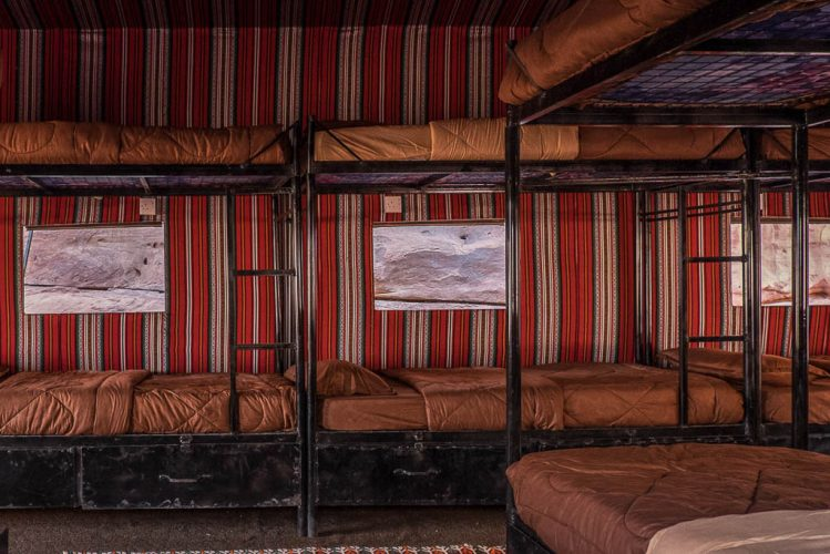 bunk beds in dormitory with bedouin fabrics - Arabian Nights Bedouin camp Wadi Rum