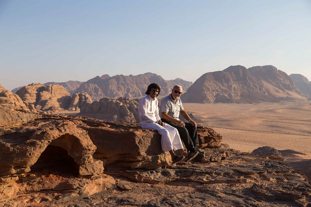 Bedouin and tourist enjoying the view inWadi Rum