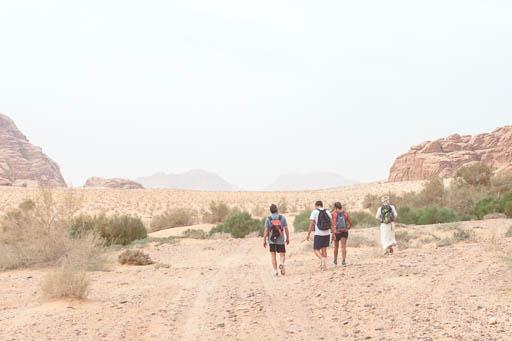 wadi rum tourists trekking in valley