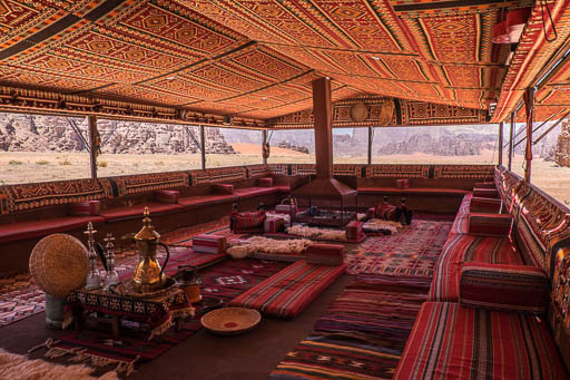 Typical Bedouin Tent with seating and geometrically patterned fabrics