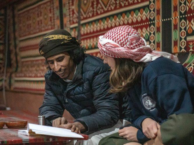 bedouin explains arabic to tourist in Wadi Rum Bedouin camp