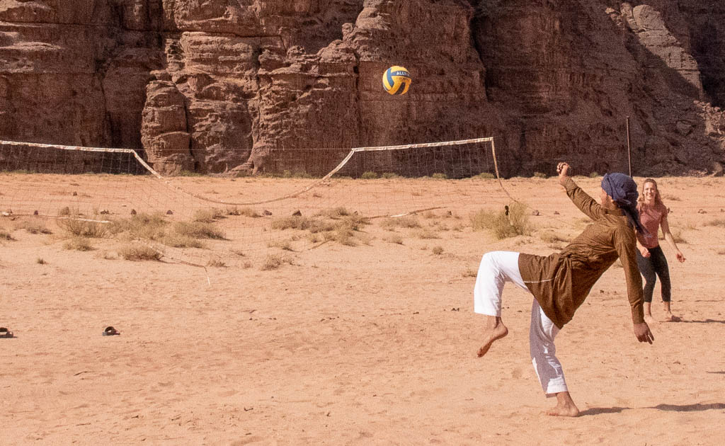 Bedouins and travellers playing volleyball, Wadi Rum, Jordan