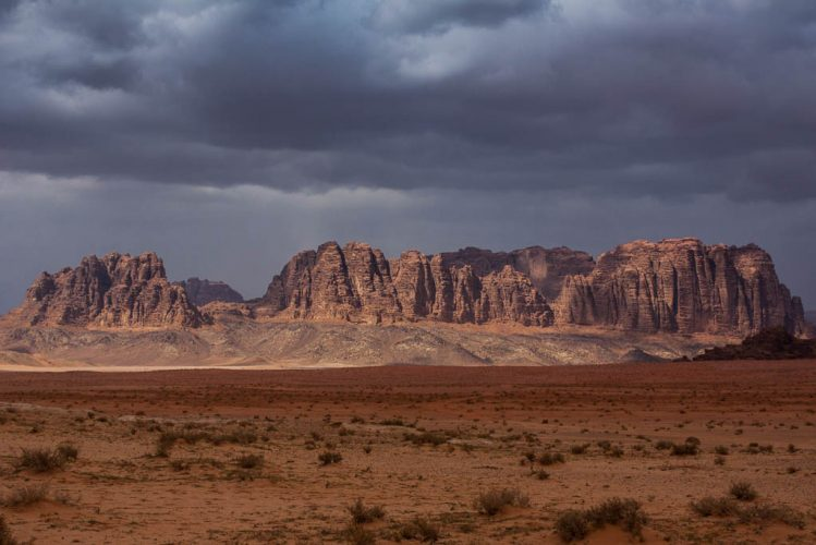 dark clouds over cliffs in wadi rum desert