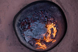 Cooking in an underground Bedouin oven, known as Zarb
